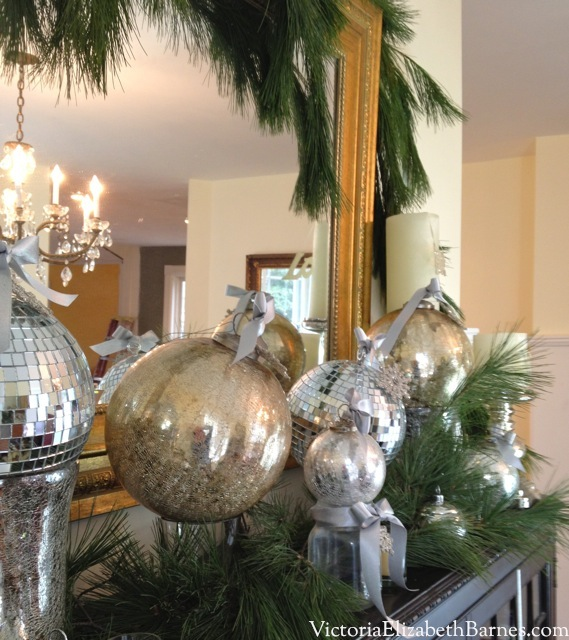 How to make a bow for Christmas decorating. How to make your dining room look elegant. Decorating with evergreen garland and mercury glass Christmas ornaments. Fast, easy Christmas decorations using household items. Adding bows to holiday ornaments